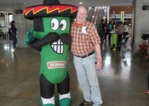 The taconacho costumed character posed with me at @commcorp communications and branding conference